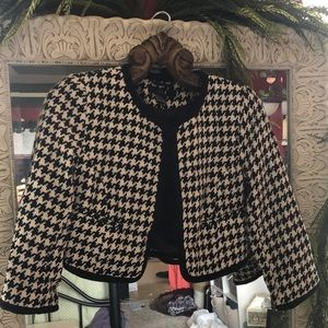 Black and white cropped professional jacket.